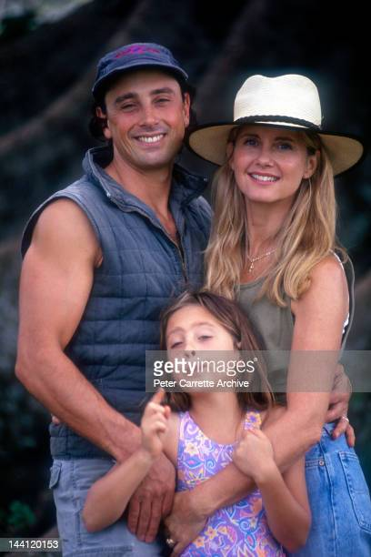 Australian actress and singer Olivia NewtonJohn with her husband Matt Lattanzi and their daughter Chloe in the garden of their home in the 1990s in...
