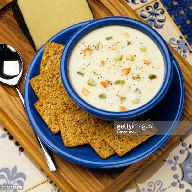 1990s BOWL OF VERMONT CHEDDAR CHEESE SOUP WITH CRACKERS