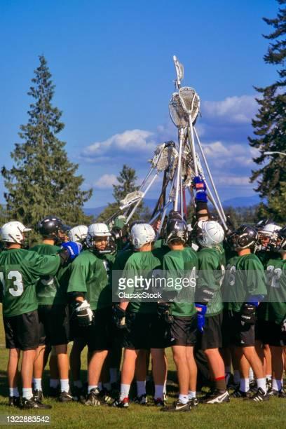 1990s Boys High School Lacrosse Team In Pre-Game Huddle.