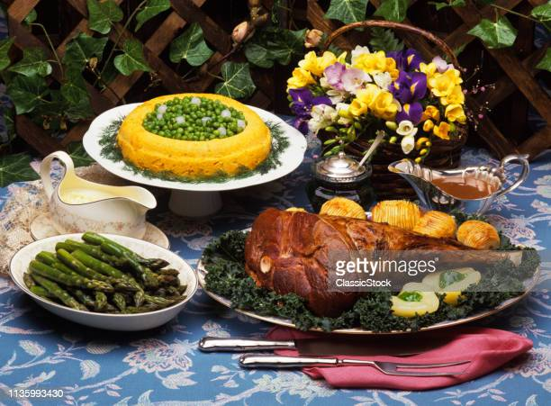 1990s EASTER FEAST ROAST LEG OF LAMB ASPARAGUS AND CARROT MOLD WITH PEAS
