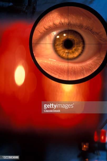 1990s Human Eyeball Eye In Cross Hairs Of Rifle Gun Scope Aiming At Target.