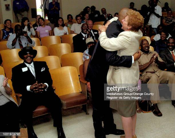8/1/05 1990s iconic wrapper Warren G hugs Mayor Beverly O'Neill during the opening of Warren G's Willie McGinest Freedom School at Sutter Academy in...