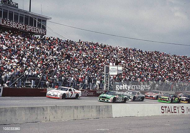 NASCAR Cup action at North Wilkesboro Speedway Alan Kulwicki leads Brett Bodine Harry Gant Kyle Petty Dale Jarrett and Rusty Wallace
