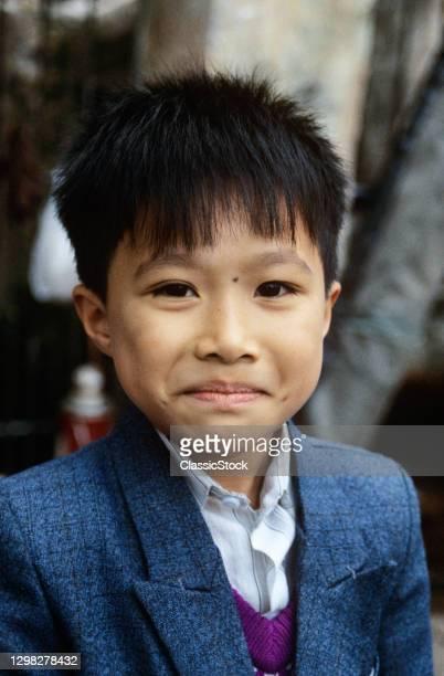 1990s Portrait Of Boy Looking At Camera Hanoi Vietnam.