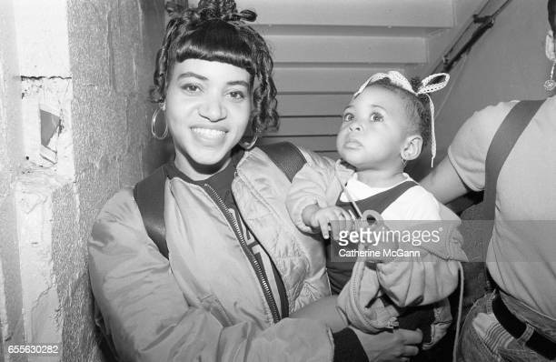Rapper Cheryl 'Salt' James of SaltnPepa poses for a photo holding her baby in the 1990s in New York City New York