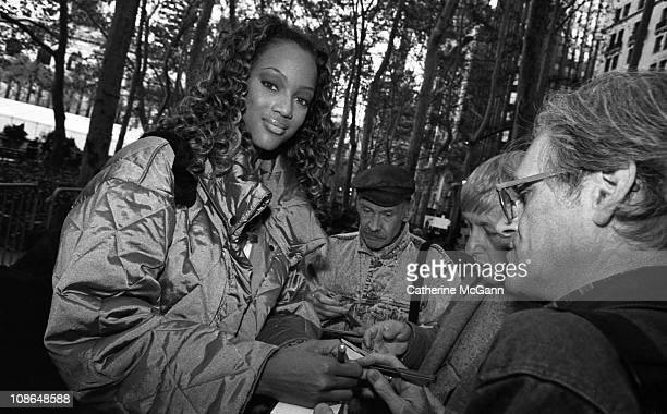 Tyra Banks signs autographs for fans during fashion week in the mid 1990s in New York City New York