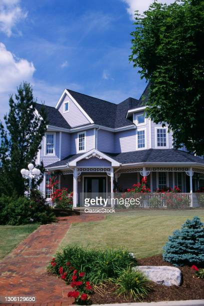 1990s Victorian style House With Porch Rose Trellis And Brick Walk.