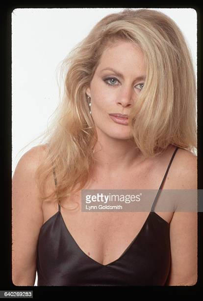 1991Actress Beverly D'Angelo is shown in this headandshoulders studio portrait wearing what appears to be a black slip or silky dress