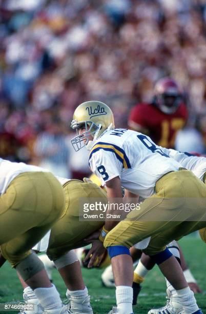 Tommy Maddox of the UCLA Bruins takes the snap at the Rose Bowl circa 1991 in Pasadena,California.