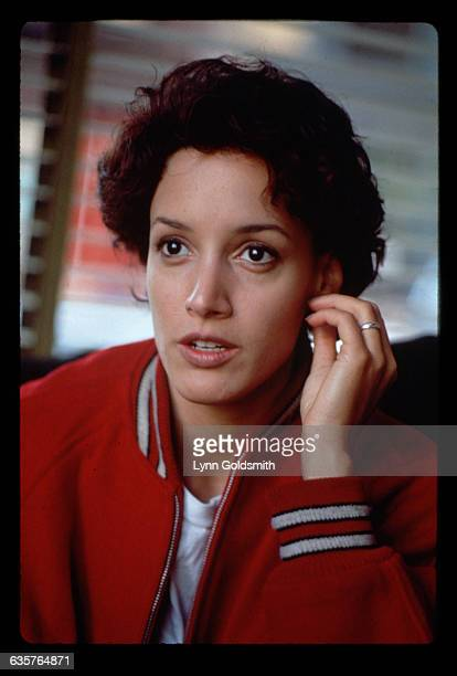 1992Actress Jennifer Beals is shown in a head and shoulders portrait holding her left hand to her ear She is seated in front of a window