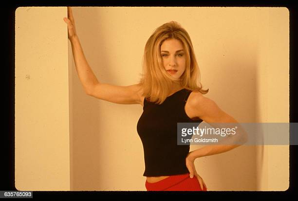 1992Actress Sarah Jessica Parker is shown in a studio portrait She wears a black sleveless shirt and a red bottom and has one hand on a wall and one...