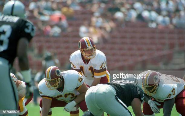 Mark Rypien of the Washington Redskins takes the snap against the Los Angeles Raiders at the Coliseum circa 1992 in Los AngelesCalifornia