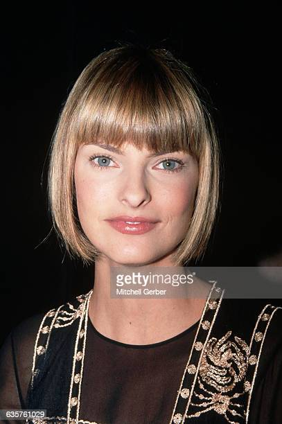 New York, NY: Picture show a head shot of model, Linda Evangelista, at the Isaac Mizrahi spring fashion show. She has a blond bob haircut and she is...