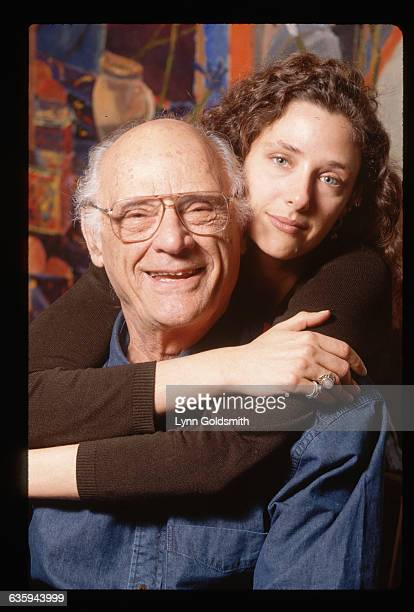 1995New York New York Picture shows famed playwrite and author Arthur Miller with his daughter Rebecca Miller standing behind him with her arms...