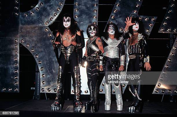 1996New York New YorkThe band members of the rock roll group Kiss posing before a giant metallic Kiss They wear full Kiss regalia The original lineup...
