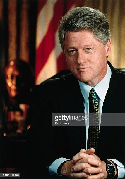 President William Jefferson Clinton in an official White House portrait Headshoulders American flag behind him