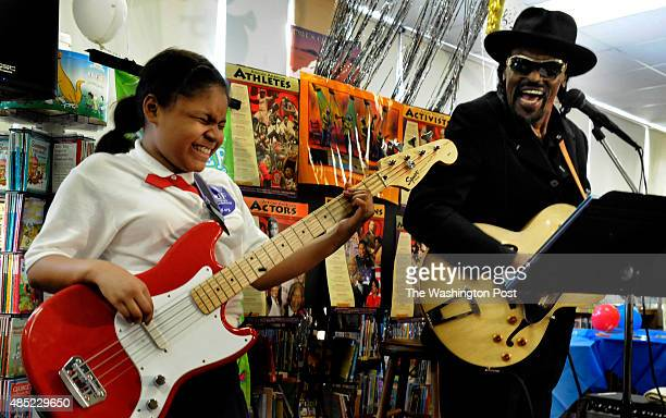 Martin Luther King Elementary school fifth grader Precious Moore hit a note while she played with Chuck Brown during Reading Is Fundamental event in...