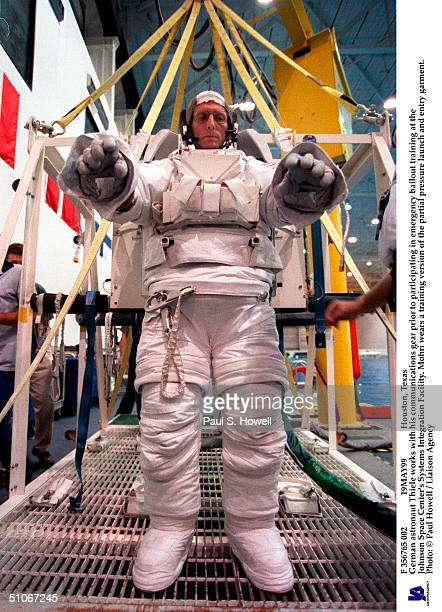 F 356765 002 19May99 Houston Texas German Astronaut Thiele Works With His Communications Gear Prior To Participating In Emergency Bailout Training At...