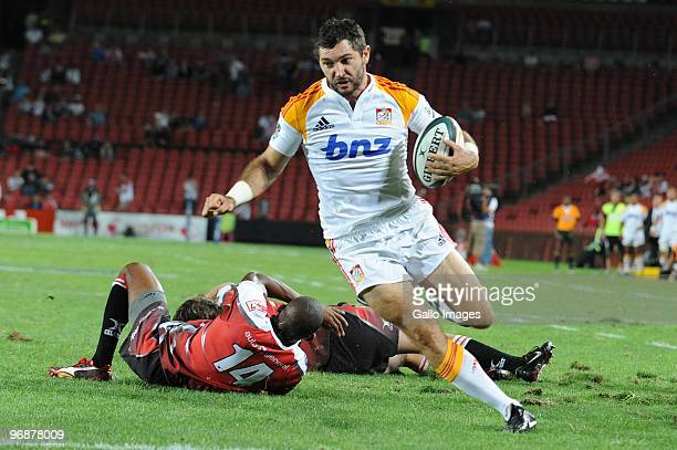 Stephen Donald of Chiefs and Tonderai Chavhanga and Cobus Grobbbelaar of Lions during the Super 14 match between Auto and General Lions and Chiefs...