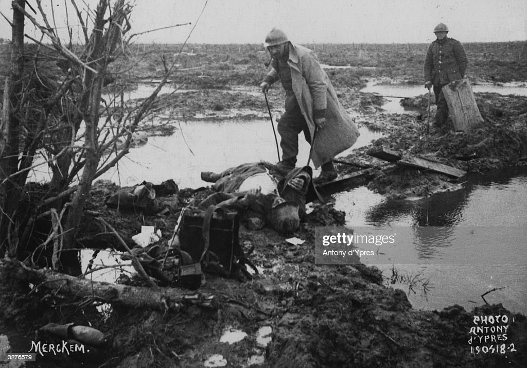 Searching for war material and other valuables after a battle near Ypres.