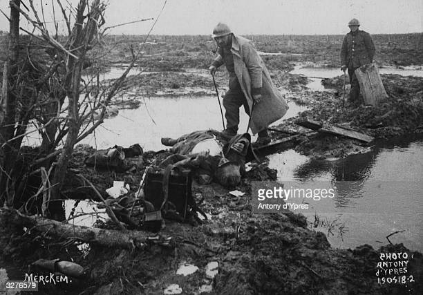Searching for war material and other valuables after a battle near Ypres