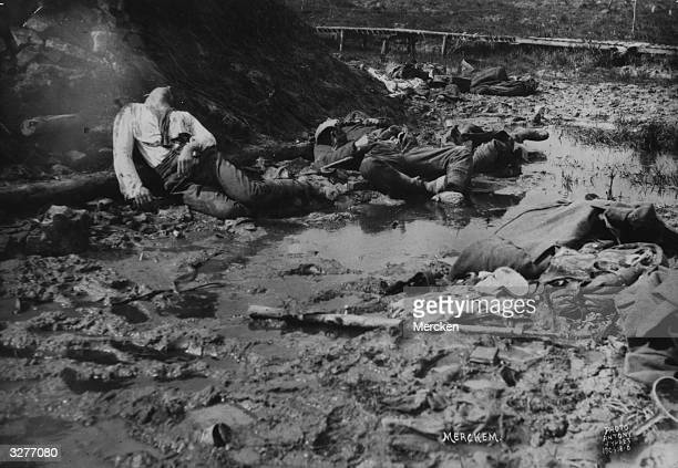 Soldiers lie dead in the mud, on a battlefield near Ypres in Belgium.