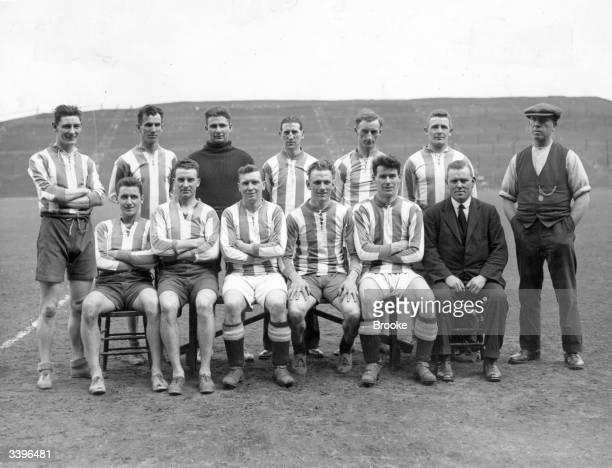 Huddersfield Football Club players left to right standing Alec Jackson W H Smith E Taylor R Kelly S Wadsworth E Barkas Archie Taylor Sitting L...