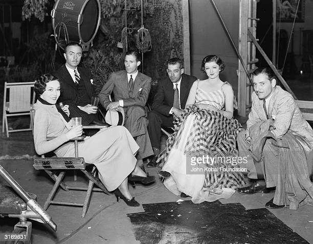 Actors Maureen O'Sullivan William Powell Myrna Loy and Ronald Colman on the set of 'The Thin Man' with the director W S Van Dyke