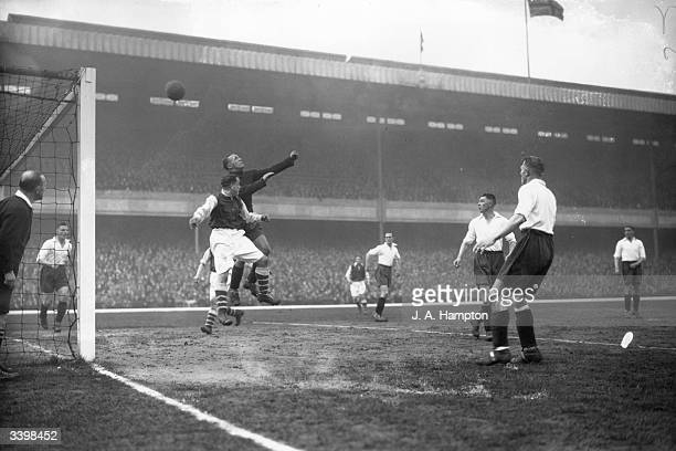 Arsenal FC v Middlesbrough FC. Middlesbrough goalkeeper punches away the ball from Alex James . Arsenal won 8-0.
