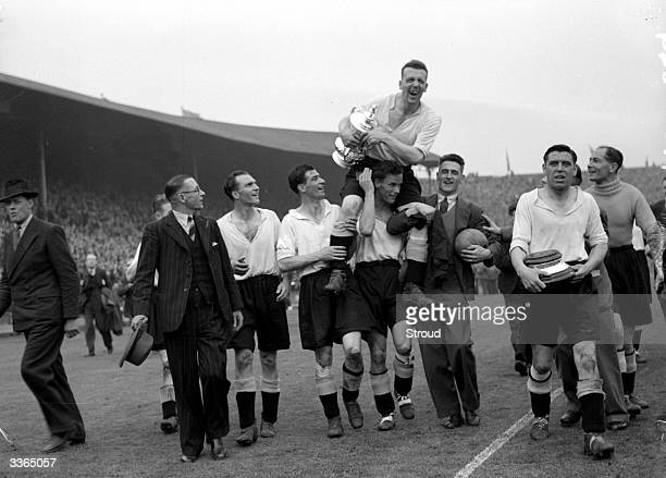 The Derby County team make a lap of honour around Wembley Stadium carrying their captain Jack Nicholas and the FA Cup trophy after their 41 victory...
