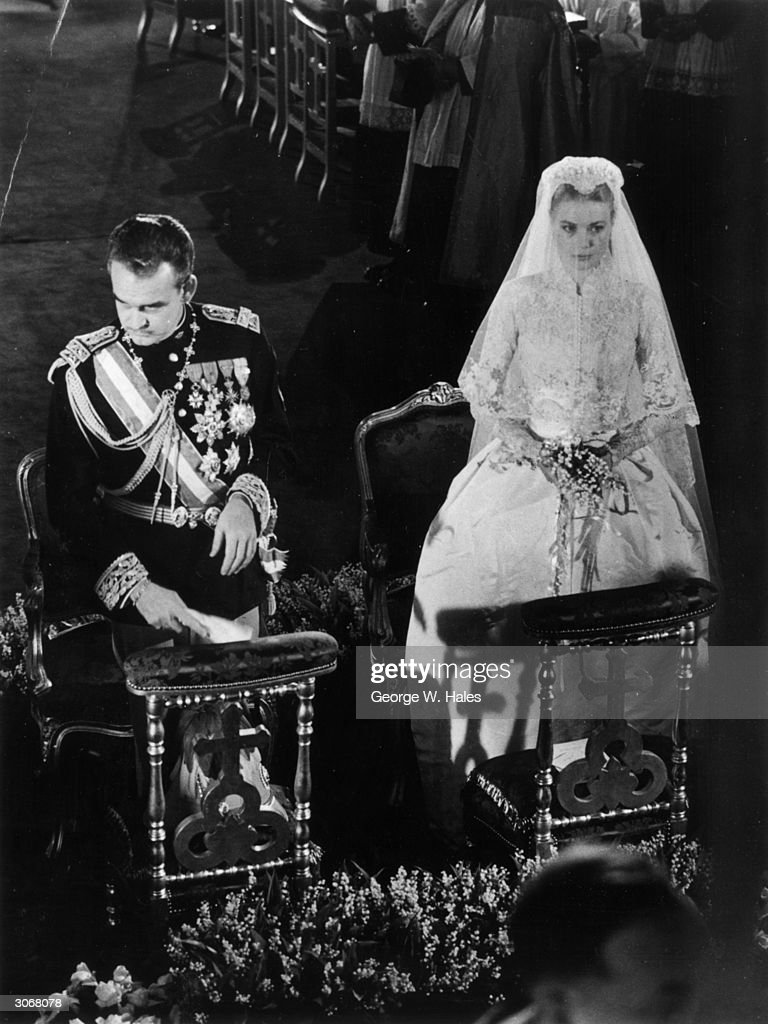 Prince Rainier of Monaco with his bride, Her Most Serene Highness Princess Grace Patricia (1929 - 1982) (Grace Kelly), during their wedding service in Monaco Cathedral.