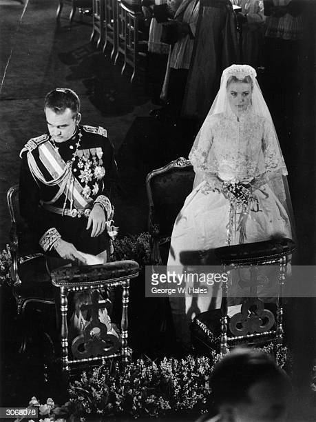 Prince Rainier of Monaco with his bride Her Most Serene Highness Princess Grace Patricia during their wedding service in Monaco Cathedral