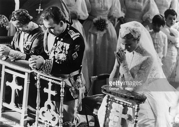 Prince Rainier of Monaco with his bride Her Most Serene Highness Princess Grace Patricia praying during their wedding service in Monaco Cathedral