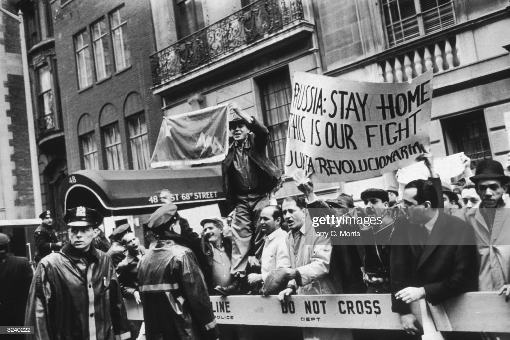 Anti-Castro demonstrators display signs near the Soviet Mission to the United Nations on 68th Street, New York City. The protest was in support of the Bay of Pigs Invasion of Cuba that had begun two days beforehand.