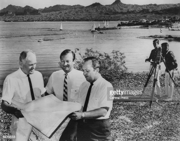 Surveying at Lake Havusa Arizona prior to reerecting London Bridge on the site