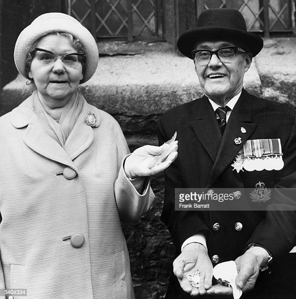 76 year old Martha Smith of Shoreditch and 74 year old Albert Piper of Hornsey display the Royal Maundy Money given to them by the Queen at the...