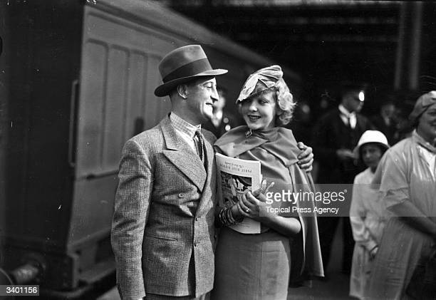 English actor, dramatist and producer Stanley Lupino kisses his daughter, Ida Lupino, goodbye at Waterloo station in London.