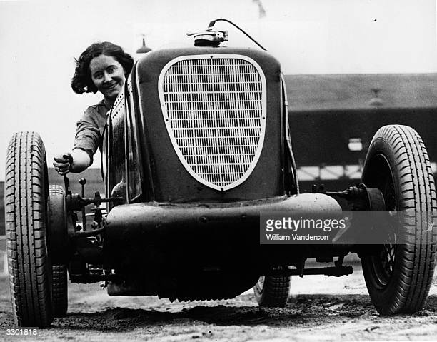 Fay Taylour driving a midget car at West Ham racetrack London