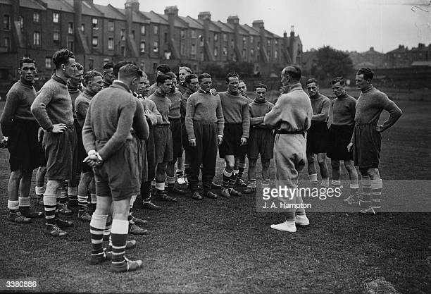 Stanley Wilson Chief Instructor of the Carnegie Physical Training College in Leeds instructs Arsenal players in London's Tufnell Park whilst Highbury...