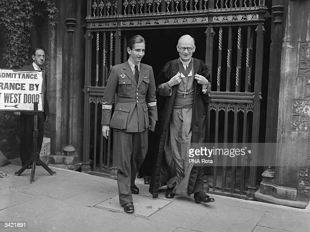 King Peter of Yugoslavia leaving Westminster Abbey London with the Dean of Westminster the Right Reverend Paul Fulcrand Delacour de Labilliere
