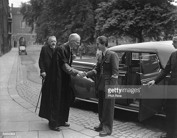The Reverend Paul Fulcrand de Labilliere Dean of Westminster greets King Peter II of Yugoslavia outside Westminster Abbey London