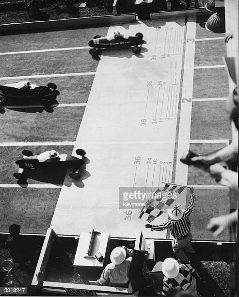 The finish of the 11th annual Soap Box Derby at Akron, USA, where young competitors race in home-made cars, won by Donald Strub , with Gary Turley...