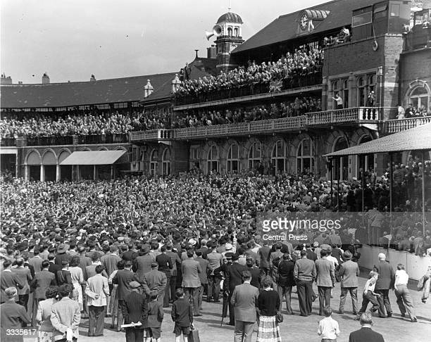 British cricketer Len Hutton acknowledges the applause of crowds gathered outside the pavilion at the end of the Test match between England and...