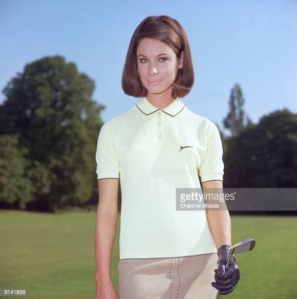 A Slazenger short sleeved cream coloured golfing shirt Collar and sleeves are edged in brown