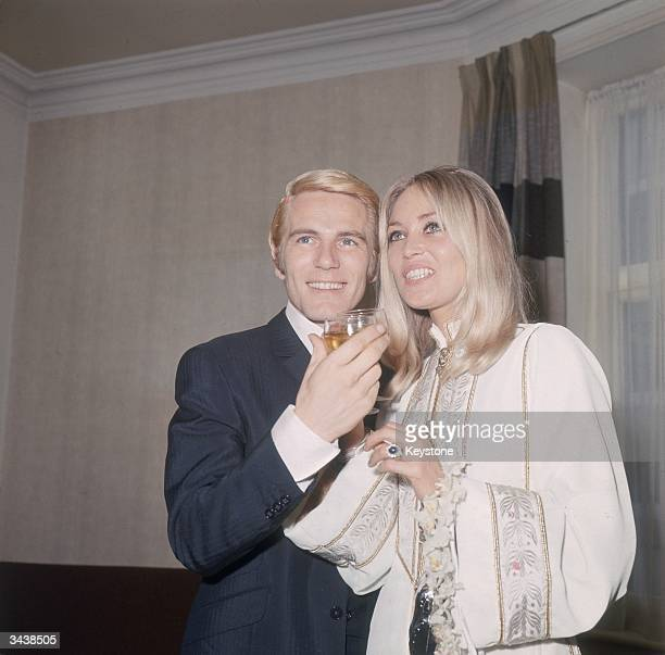 Pop singer and actor Adam Faith with his wife Jackie Irving after their wedding at Caxton Hall registry office in London