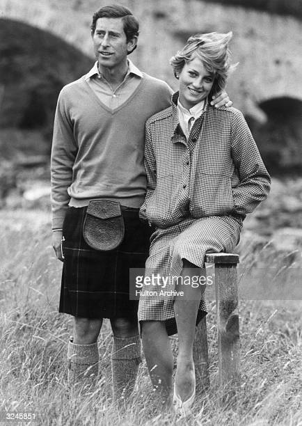 Prince Charles and Princess Diana pose together during their honeymoon Balmoral Scotland Charles is dressed in a kilt and leather sporran while Diana...