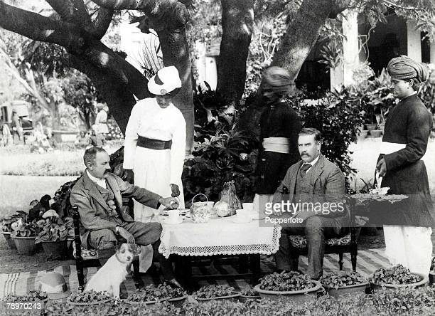 19th Century, India, servants waiting at a table, This picture was taken at Bangalore, showing General, R,G,Woodthorpe on the left, with his guest,...