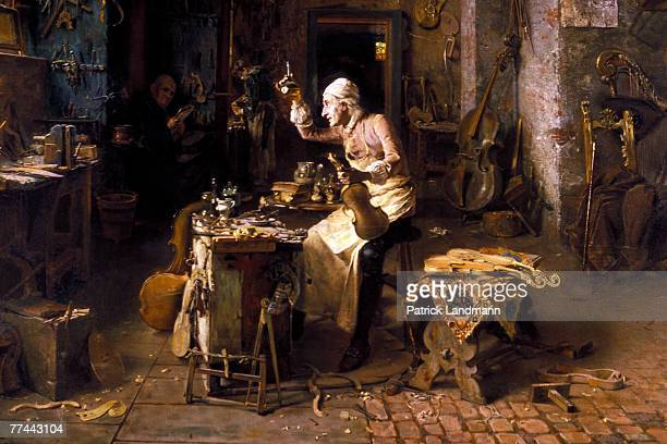 A 19th century painting of Antonio Stradivari in his workshop on display in the Violins' Room of the Cremona's town hall The historical city of...