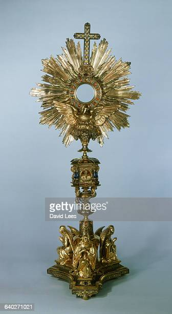 A 19th century papal monstrance of silver gilded silver niello topaz and precious stones made by D De La Touche of Paris France Three angels surround...