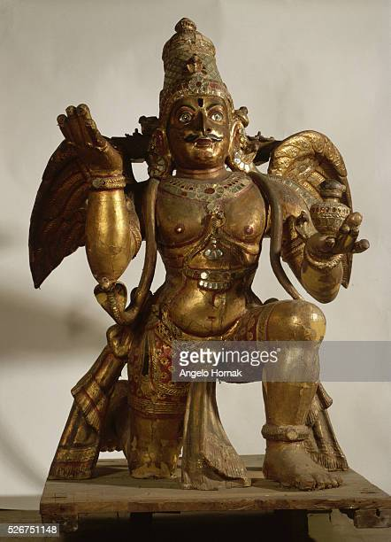 A 19th century Tamilnadu Garuda carrier of Lord Vishnu made from wood and glass measures 150 x 110 cm | Located in National Museum of India
